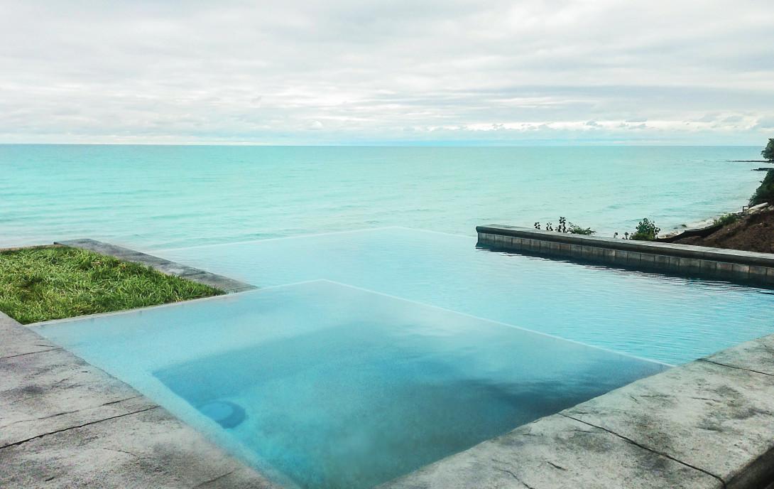 inground pool, Irondequoit Bay, Rochester NY, Lake Ontario, negative edge pool, gunite swimming pool, lakefront pool and spa, infinity pool