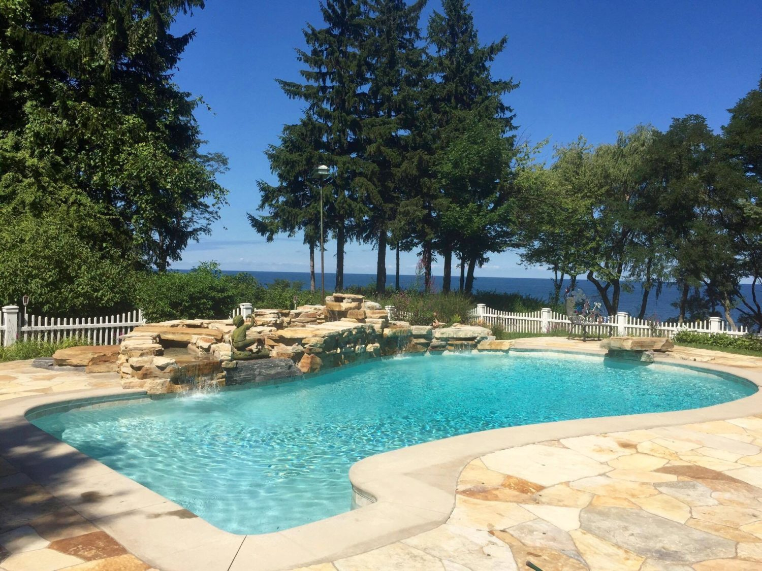 inground pool, Waterfront Pool with Rockwall, Waterfall, grotto, Irondequoit Bay, Rochester NY, Lake Ontario, Precision Pool and Spa