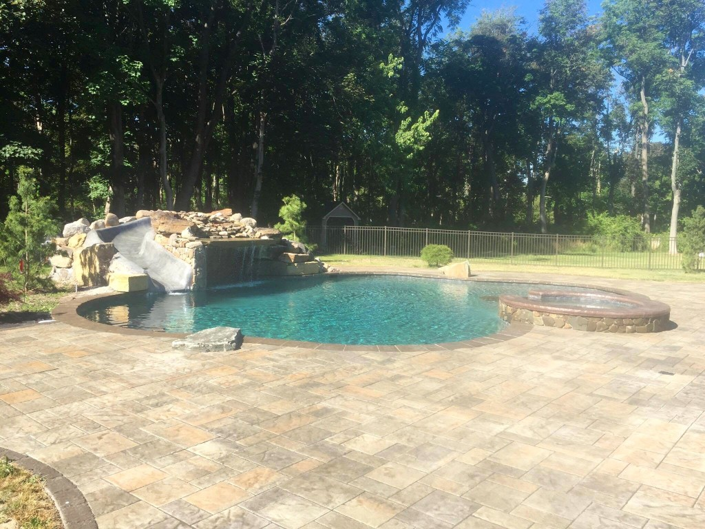 inground pool, Grotto, pool and spa combo, dive rock, water slide, natural pool, precision pool and spa design, leisure pool, pool installation, hot tub