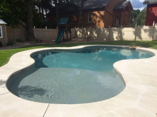 In-ground pool with sun ledge